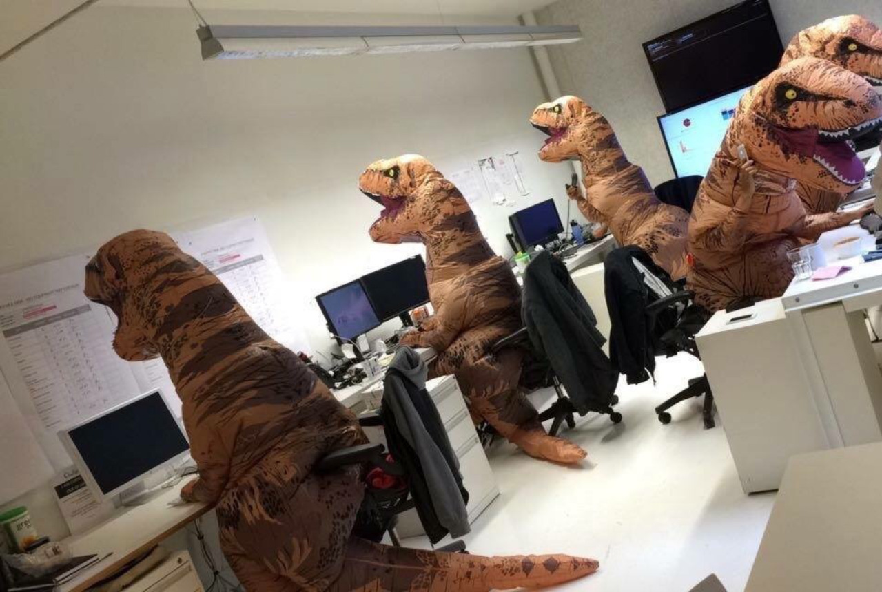 Programmers in dinosaur costumes